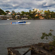 CityCat passenger ferry motoring up river in front of the old powerhouse.