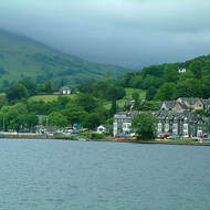 Grey and overcast weather over the hills behind Lake Windermere.