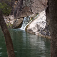 Coomba Falls over the granites and into a deep waterhole.