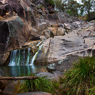 Coomba Falls over the granites into the waterhole.