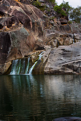 Thumbnail image ofCoomba Falls reflected in the waterhole.