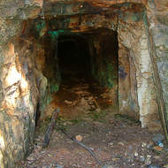 Looking along the adit deeper into the abandoned Gadens copper mine.