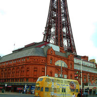 One of Blackpool's heritage trams running in front of the Blackpool Tower.