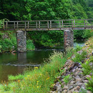 Walking bridge of the River Rothay at Rydal Water.