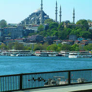 Looking up at the Sultan Ahmet Mosque from the Galata Bridge and the ferryboat terminal.