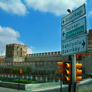 Walls and turrets of the Topkapi Palace and the directions to the Cevre Yolu beltway.