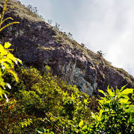 The rocky bluff of Mount Warning seen from the walking track to the summit.
