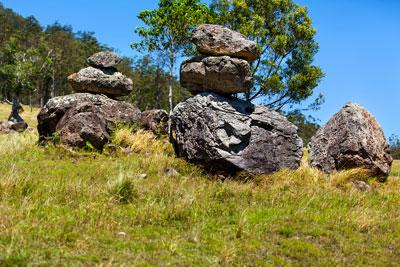 Thumbnail image ofBalancing act. Weathered boulders at the base...