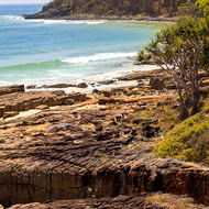 The rocky shore line of Tea Tree Bay.
