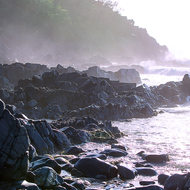 Lavender light of early morning sun lights the sea mist at Hells Gates.