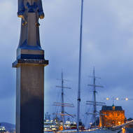 Statue of Shetlands Leif Larsen at the end of Bergen's Vagen harbour.