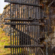 Rusting hand forged gate at Fredriksberg fortress.