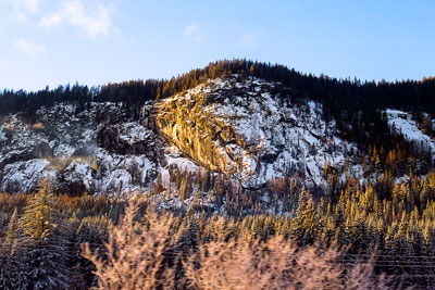 Thumbnail image ofLow sun highlights the crags beside Oslo-Bergen...