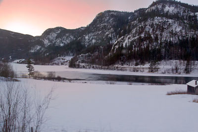 Thumbnail image ofPale sunset over a river beside the Oslo-Bergen...