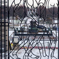 Wrought iron gate, and beyond, the fountain.