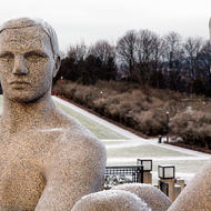 Granite statues surrounding the monolith at the highest point of the Vigeland Sculpture Park.