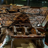 Detail of the carved funerary carriage from a Viking boat.