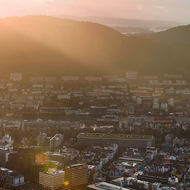 The sun sets over the mountains around Bergen, panorama from Mount Floyen.