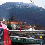 Bergen railway station with Mount Ulriken as backdrop.