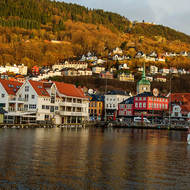 A rare burst of sun lights up Vagen harbor, the fish market, St. Olav's church and the funicular railway.