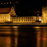 Nightime: Rosenkrantz Tower and the Bergenhus Fortress over the Vagen harbor.