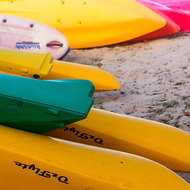 Lined up, kayaks for hire along the Noosa River.