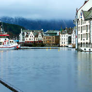 Just gone noon, with low cloud and rain over Alesund harbor.