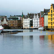 Downtown Alesund, bright buildings and dull sky.