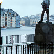 Rope at the ready, statue beside Alesund harbor.