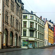 Almost deserted midday street in Alesund.