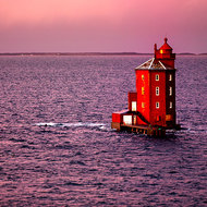 Destinctive, recognizable; the red octagonal Kjeungskjaer lighthouse.