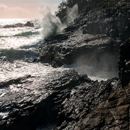 Waves pound the rocks at the Blowhole.