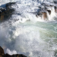Waves pounding against the rocky shore.