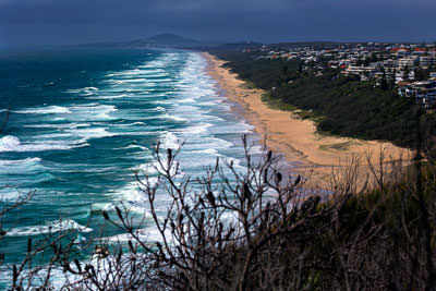 Thumbnail image of Surf's up along the long stretch of Sunshine Beach;...