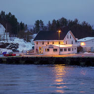 Welcome to Finnsnes, wharf and lighthouse.