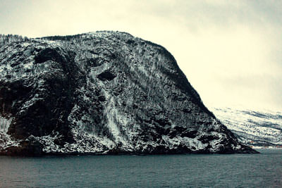 Thumbnail image ofRocky mountain rises straight from the sea.