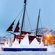 Sculpture to sailing ships at Hammerfest harborside.
