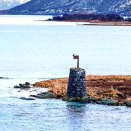 Old and the new; old style navigation marker and newish lighthouse.