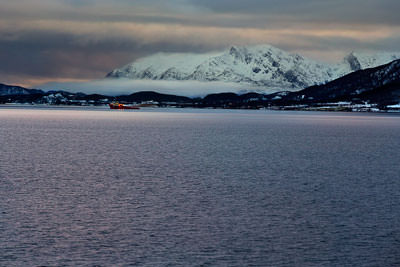Thumbnail image ofCloud low girdling the mountain and a workboat...