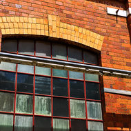 Arched frame and window of workshop buildings.
