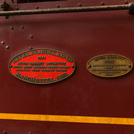 Nameplates under the driver's cab of Beyer Garratt steam locomotive 1009.