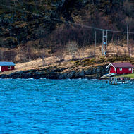 The wharf at the small town of Nesna, mountains obscured by low cloud.