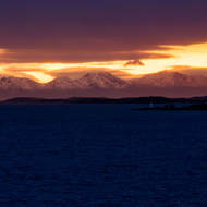 Small lighthouse on rocky shore.