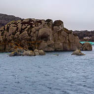 Fish farming behind the rocks.