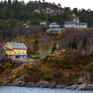 Coastal houses, and not one Norwegian standard red in sight.
