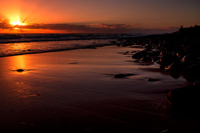 Thumbnail image ofWide shot of the beach at low tide and the rising...