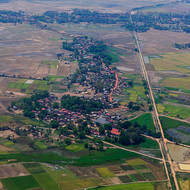 Small village surrounded by rice paddy fields on the outskirts of Siem Reap.