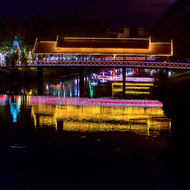 Brightly lit pedestrian bridge over the Siem Reap River.