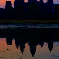 Pre-sunrise colors of the sky and the on the western side of Angkor Wat.