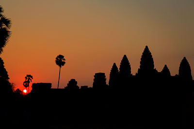 Thumbnail image ofThe sun rises over the west side of Angkor Wat.